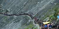 SRINAGAR, JULY 5 (UNI)- Amarnatha pilgrims on way to bound to Holy cave shrine of Amarnath for Darshan of self made Ice Shivlingam crossing a terrain at Baltal in North Kashmir on Sunday. UNI PHOTO-10U